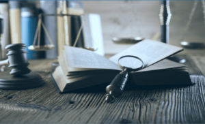 Magnifying Glass, Gavel, and Book on desk